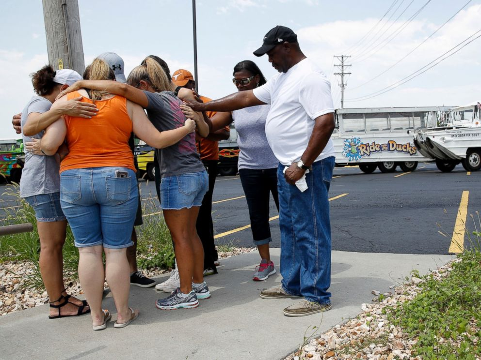 People pray outside Ride the Ducks, an amphibious tour operator involved in a boating accident on Table Rock Lake, Friday, July 20, 2018 in Branson, Mo.