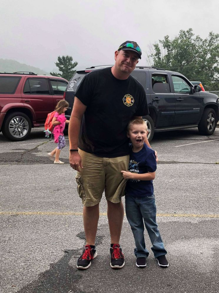 PHOTO: Cooper Brooks, 5, seen in August 2018 on his first day of kindergarten with assistant fire chief John Kemp, who brought him to school that day.