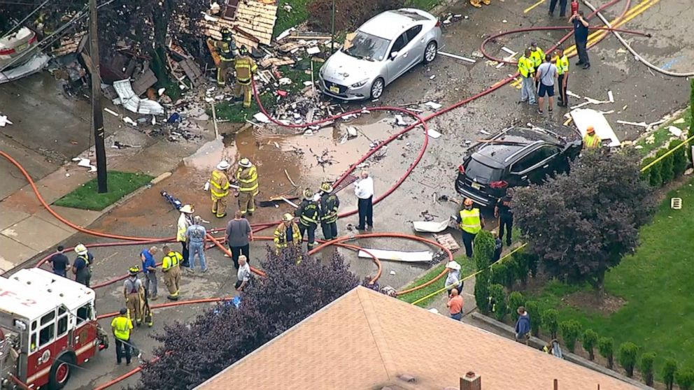 PHOTO: An explosion brought down a Ridgefield, New Jersey house Monday, covering the road, backyard and littering surrounding property with debris.