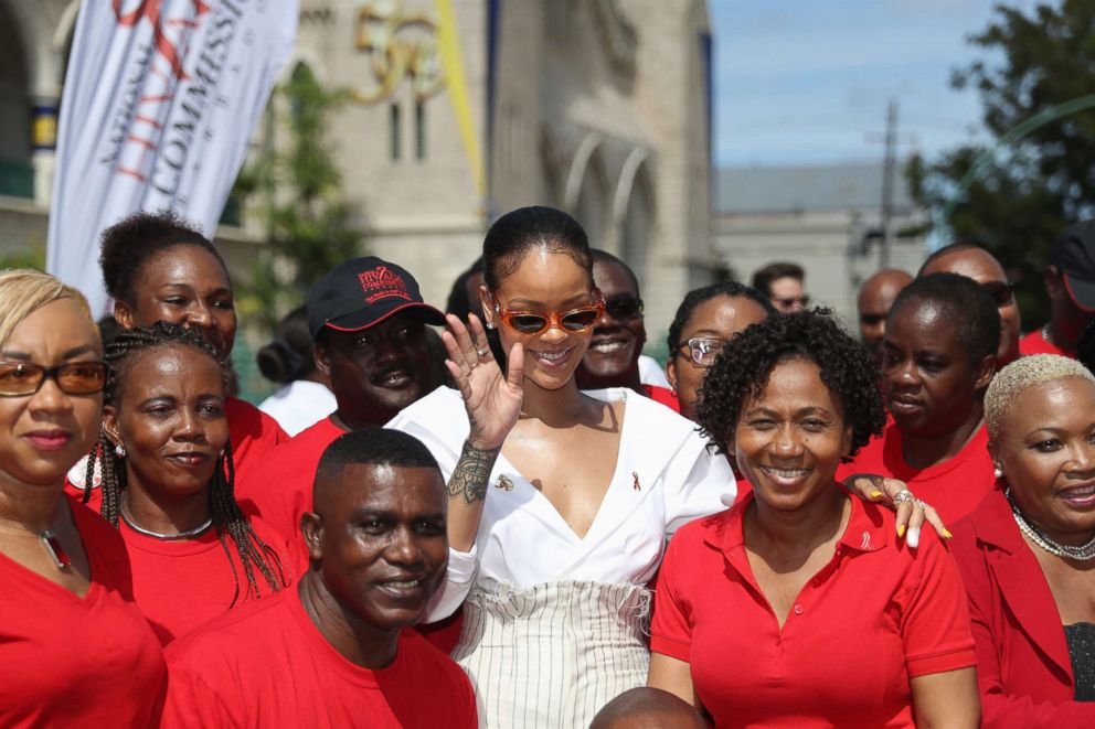 PHOTO: Rihanna poses with volunteers at the Man Aware event held by the Barbados National HIV/AIDS Commission on Dec. 1, 2016 in Bridgetown, Barbados.