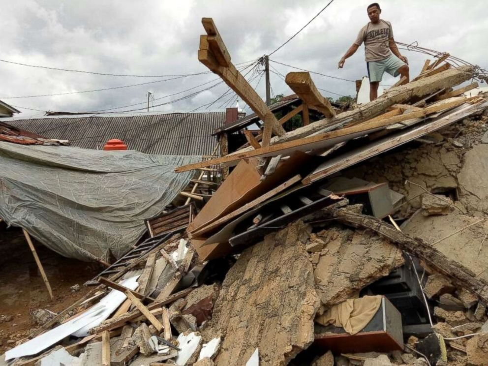 PHOTO: A resident stands on his damaged house after an earthquake at Megamendung village in Bogor, Indonesia, Jan. 23, 2018.