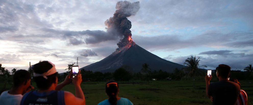 PHOTO: Residents watch the glowing lava flowing from the crater of the Mount Mayon volcano as it erupts in Albay Province, the Philippines, Jan. 23, 2018.