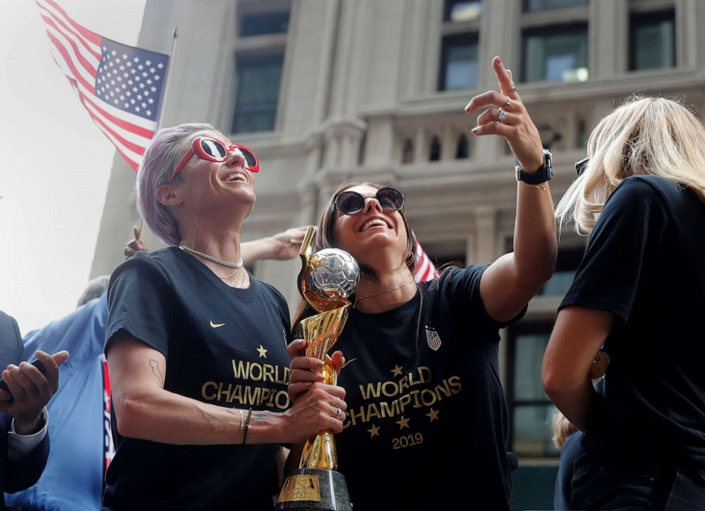 PHOTO: Megan Rapinoe and Alex Morgan hold the trophy during the parade honoring the U.S. Womens National team following the World Cup championship, July 10, 2019, in New York.