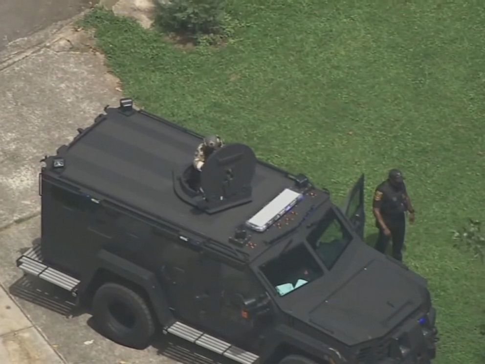A DeKalb County, Georgia, SWAT team stormed a house in an Atlanta suburb on July 22, 2019, and arrested a 23-year-old man suspected of being involved in the shooting a Good Samaritan who tried to break up a road rage confrontation. PHOTO: