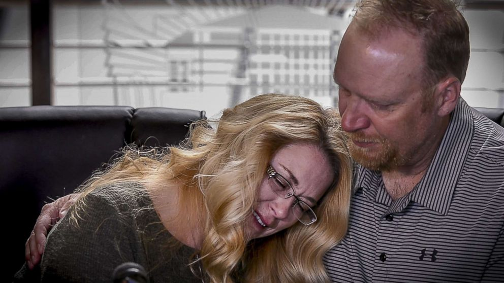 PHOTO: Kerrie Harter leans onto her husband Mike Harter, parents of Cody Harter, to sob as they speak during a press conference, May 6, 2018, in the lobby of Lees Summit police headquarters in Lees Summit, Mo.