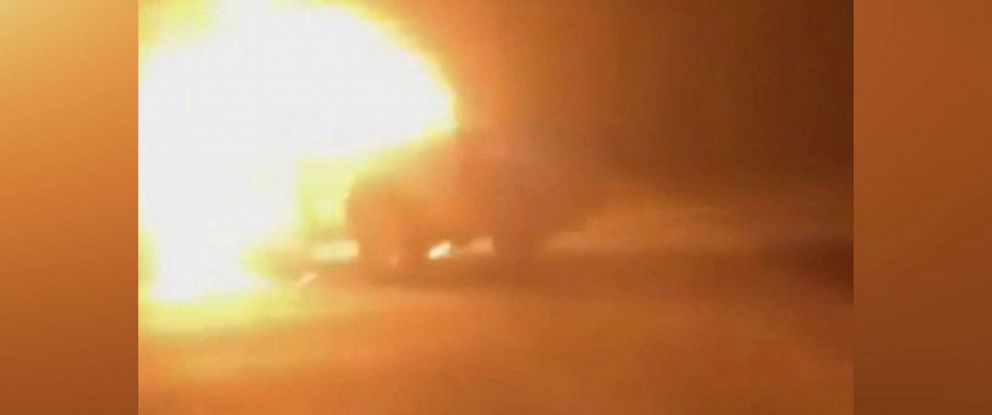 PHOTO: An image made from video shows a car burning after a road rage incident in Houston, July 4, 2019.