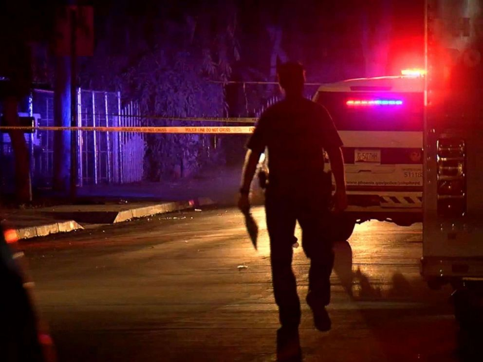 PHOTO: Police at the scene of a shooting in Phoenix, Ariz, April 3, 2019, following an apparent road rage shooting which killed a 10-year-old girl and injured her father.