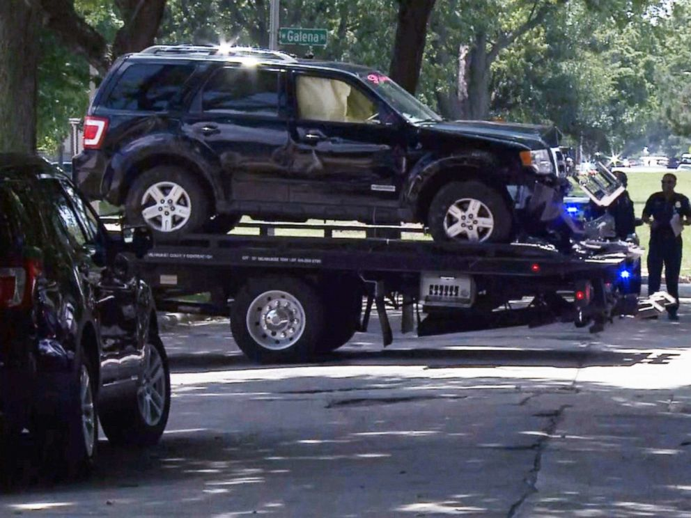 PHOTO: Police tow away a black Ford SUV they say was driving by a suspect in an apparent road-rage shooting on July 13, 2019, in Milwaukee that left 3-year-old Brooklyn Harris dead.