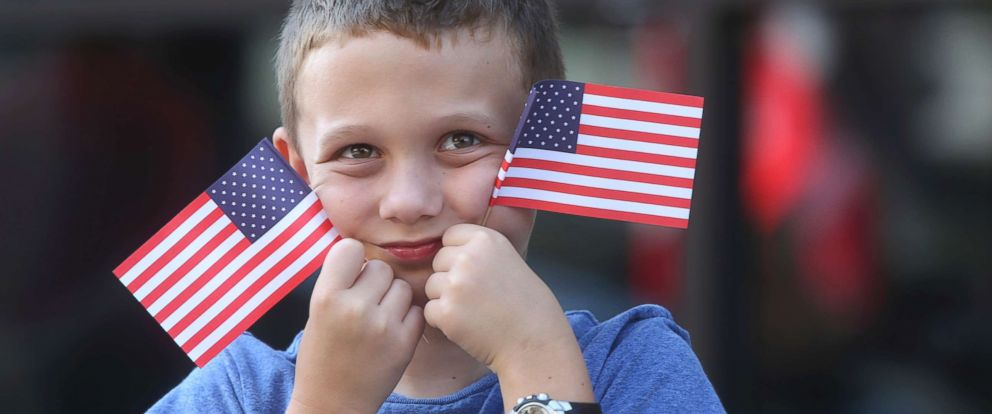 PHOTO: Noah Hazen, 7, of Houston, Texas watches as large trucks drive by on Campbell Avenue SW honoring our veterans during the Roanoke Labor Day Parade, Sept. 1, 2018, in Roanoke, Va.