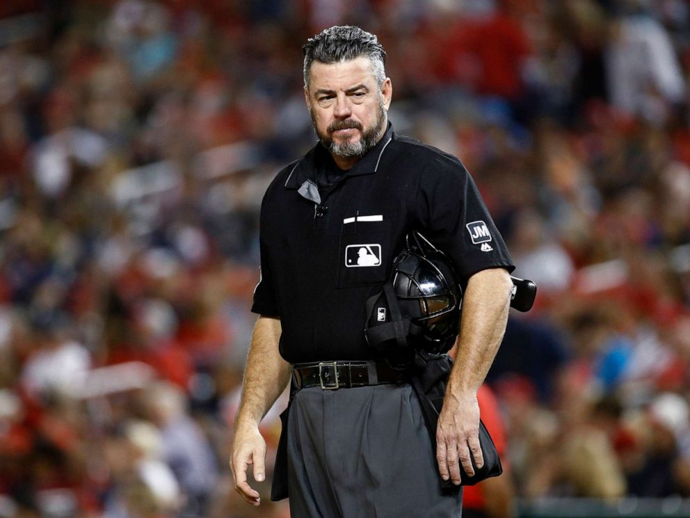 PHOTO: Umpire Rob Drake stands on the field during a baseball game between the Atlanta Braves and the Washington Nationals in Washington,Sept. 13, 2019.