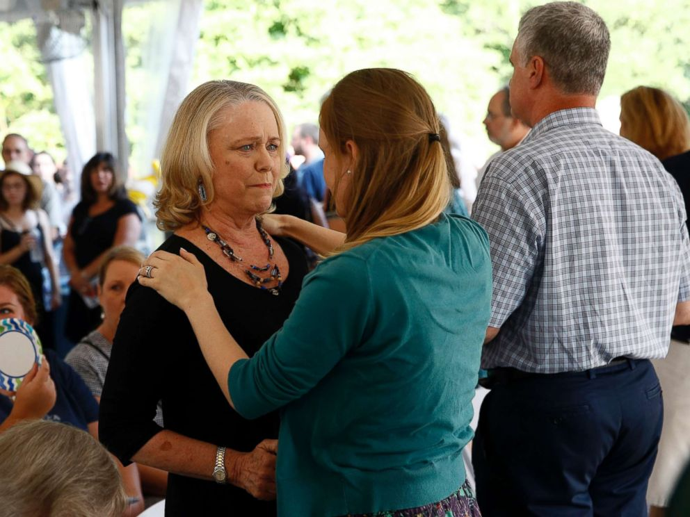 PHOTO: Judy Hiaasen, left, sister of Rob Hiaasen, one of the journalists killed in the shooting at The Capital Gazette newspaper offices, speaks with a mourner during a memorial service, July 2, 2018, in Owings Mills, Md.