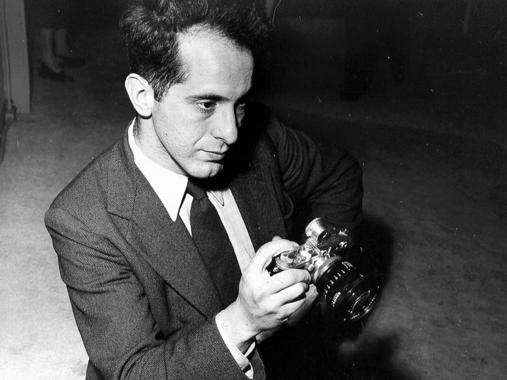 PHOTO: American photographer Robert Frank holding a pre-war Leica camera, 1954.