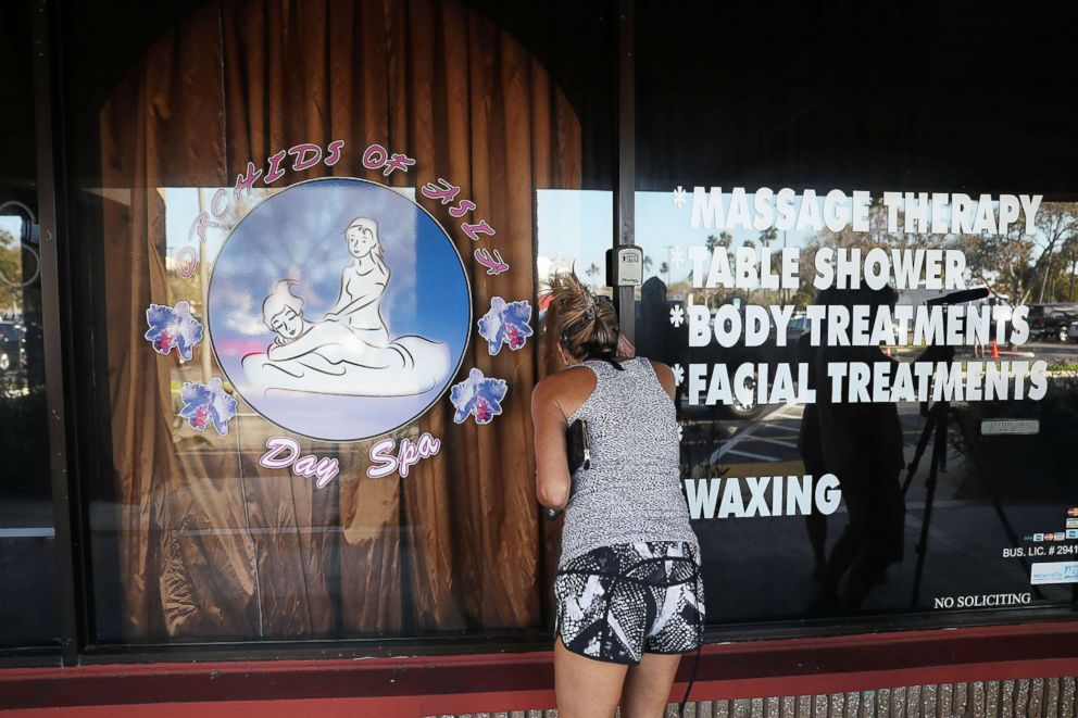 PHOTO: A person looks in a window of the Orchids of Asia Day Spa where New England Patriots owner Robert Kraft is charged with allegedly soliciting for sex on Feb. 22, 2019 in Jupiter, Fla.