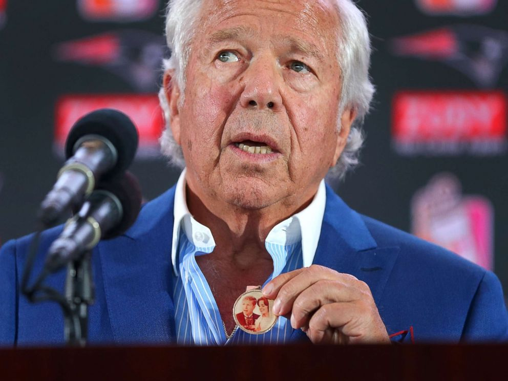 PHOTO: New England Patriots owner Robert Kraft holds a medal containing a wedding photo of him and his late wife Myra at a press conference in Foxborough, Mass., Aug. 9, 2017. Kraft said he wore if for 11 months straight after she died.