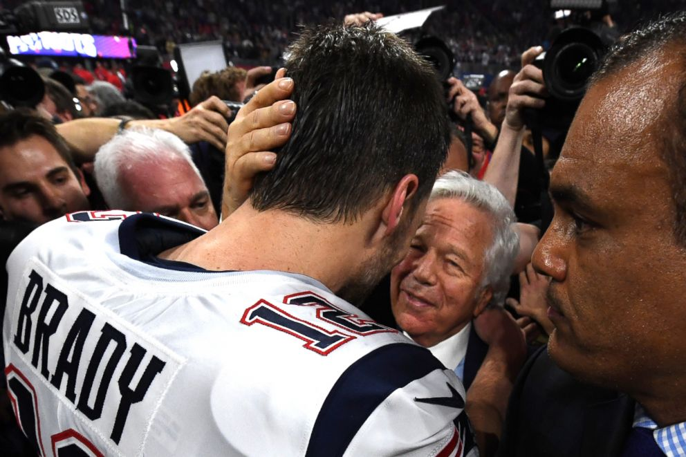 New England Patriots Quarterback Tom Brady celebrates with owner Robert Kraft after Super Bowl LIII between the New England Patriots and the Los Angeles Rams in Atlanta, Feb. 3, 2019.