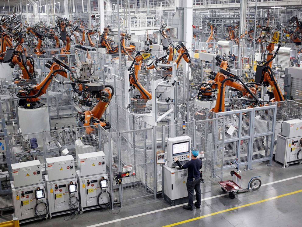PHOTO: Robots weld car body components for vehicles at a BMW assembly plant in Greer, S.C., May 10, 2018.