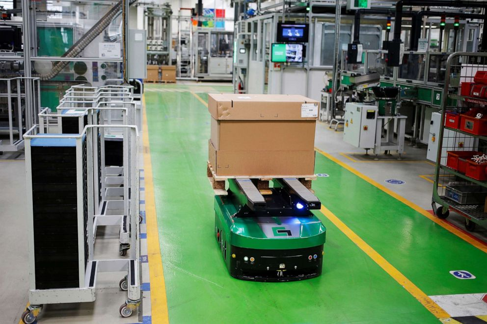 PHOTO: A robot carries a box in a production plant owned by French electrical equipment giant Schneider Electric in Le Vaudreuil, northwestern France, Feb. 21, 2019.