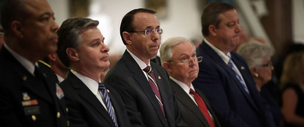 """PHOTO: Attorney General Jeff Sessions (2nd R), Deputy Attorney General Rod Rosenstein (C) and FBI Director Christoper Wray (2nd L) attend the 24th annual """"Blue Mass"""" at St. Patricks Catholic Church, May 1, 2018, in Washington, D.C."""