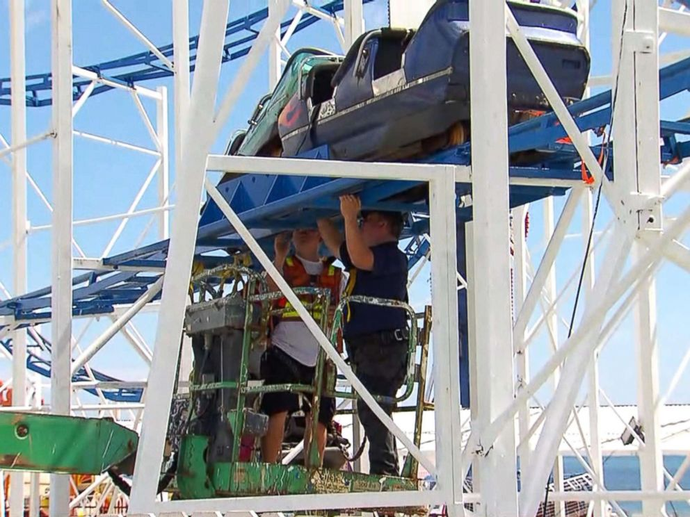 PHOTO: Officials inspect the sandblaster roller coaster at Daytona Beachs boardwalk.
