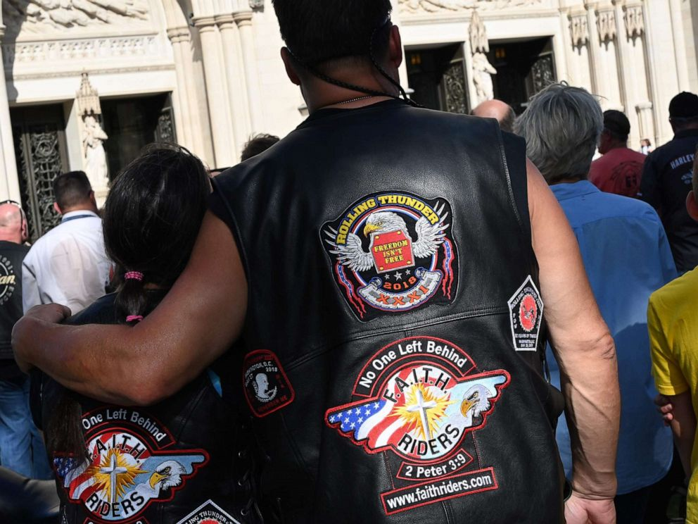 PHOTO: Motorcyclists are watching Clergyman Rev. Andrew K. Barnett perform the Blessing of the Bikes at the Washington National Cathedral, May 24, 2019, in Washington, D.C.