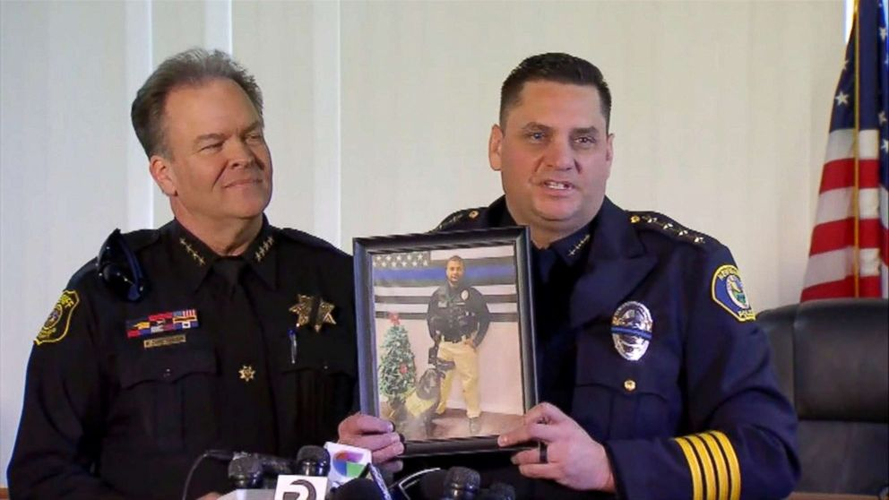 Newman, California Police Chief Randy Richardson holds up a photo of Cpl. Ronil Singh as Stanislaus County Sheriff Adam Christianson stands next to him during a press conference on Dec. 27, 2018.