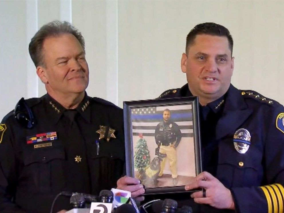 PHOTO: Newman, California Police Chief Randy Richardson holds up a photo of Cpl. Ronil Singh as Stanislaus County Sheriff Adam Christianson stands next to him during a press conference on Dec. 27, 2018.