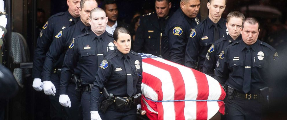 "PHOTO: Newman police officers carry the body of their slain colleague Cpl. Ronil ""Ron"" Singh during his funeral on Jan. 5, 2019, in Modesto, Calif."
