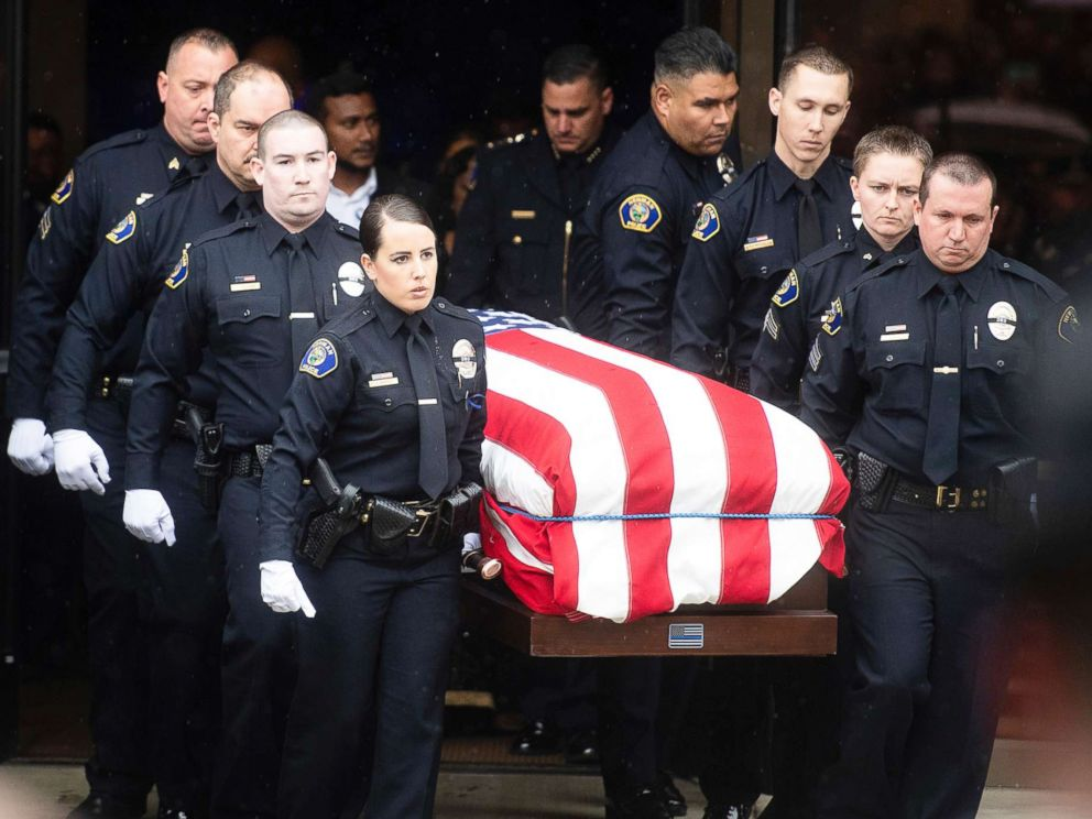 PHOTO: Newman police officers carry the body of their slain colleague Cpl. Ronil Ron Singh during his funeral on Jan. 5, 2019, in Modesto, Calif.