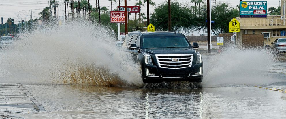 PHOTO: In this Sunday, Sept. 30, 2018 photo, a vehicle drives east on a flooded street following a rain storm, in Yuma, Ariz. Tropical Storm Rosa neared Mexicos Baja California on Monday, spreading heavy rains to the U.S. Southwest.