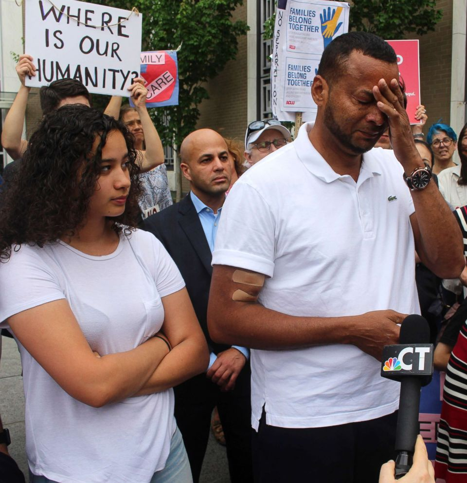 PHOTO: Nelson Rosales Santos, 49, an immigrant who lives in Stamford, Conn., talks to reporters while standing next to his 14-year-old daughter, Samantha, during a rally outside the federal bridling in Hartford, Conn., June 14, 2018.