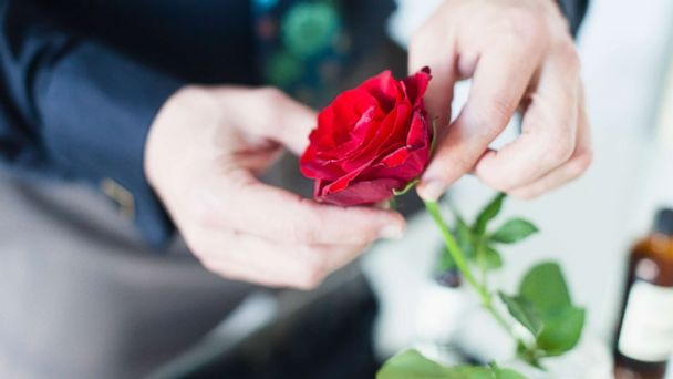 Group of good guys hands out roses to single women, widows and military wives on Valentine's Day