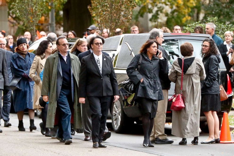 PHOTO: Visitors walk past the hearse as they gather for the funeral of Rose Mallinger, 97, at Congregation Rodef Shalom, Nov. 2, 2018, in Pittsburgh.