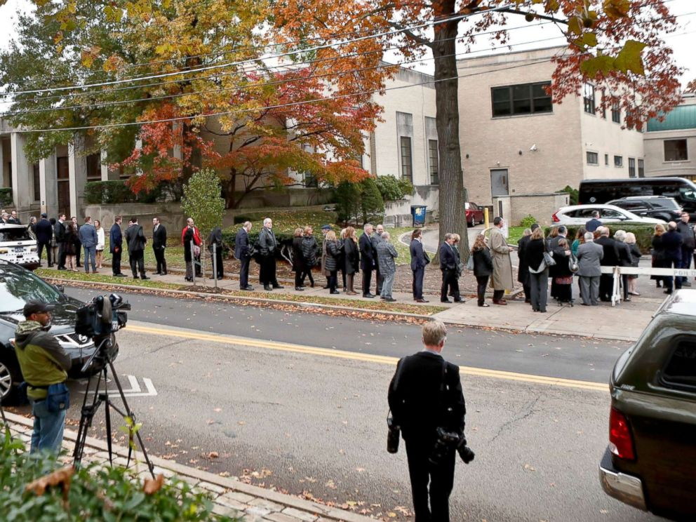 PHOTO: Camera crews record the hundreds of visitors gathering for the funeral of Rose Mallinger, 97, at Congregation Rodef Shalom, Nov. 2, 2018, in Pittsburgh.