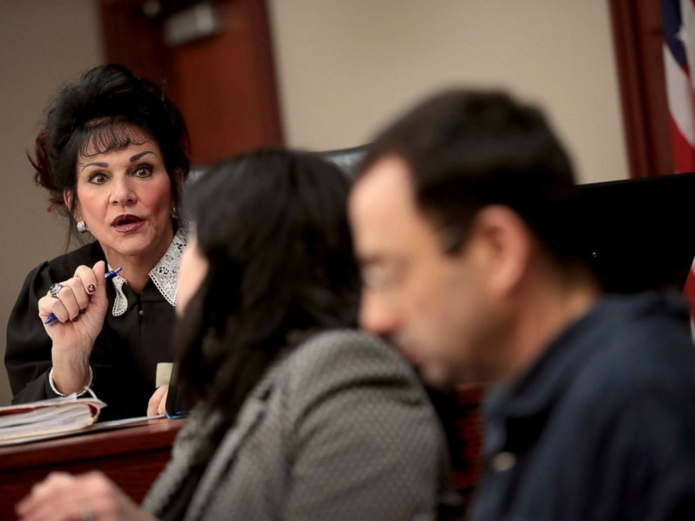 PHOTO: Judge Rosemarie Aquilina speaks with Larry Nassar, right, and his attorney Shannon Smith as he appears in court, Jan. 16, 2018, in Lansing, Mich.