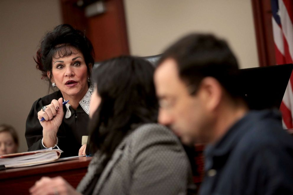 PHOTO: Judge Rosemarie Aquilina speaks with Larry Nassar, right, and his attorney Shannon Smith as he appears in court, Jan. 16, 2018, in Lansing, Michigan.