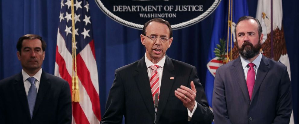 PHOTO: U.S. Deputy Attorney General Rod Rosenstein, center, holds a news conference at the Department of Justice, July 13, 2018, in Washington.
