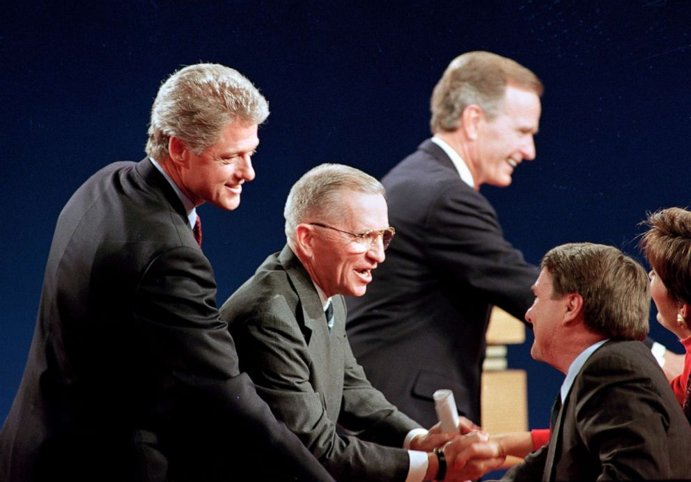 PHOTO: Democratic presidential candidate Gov. Bill Clinton, left, Independent Ross Perot and President George Bush shake hands with the panelists following their third presidential debate at Michigan State University in East Lansing, Mich., Oct. 19, 1992.