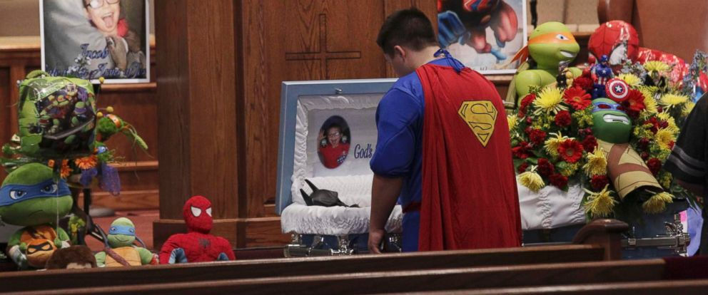 PHOTO: Dale Hall, dressed in a Superman outfit, stands before the casket during the funeral for his brother 6-year-old Jacob Hall at Oakdale Baptist in Townville, South Carolina, Oct. 5, 2016.