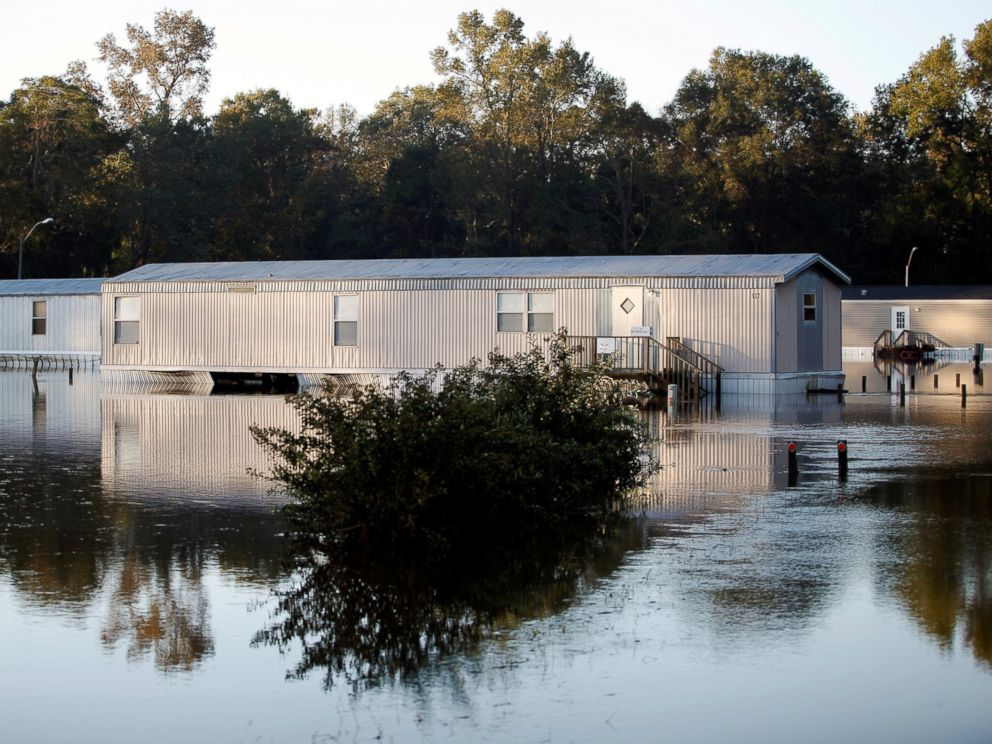 PHOTO: Mobile homes are reflected in the flood waters after Hurricane Matthew caused severe flooding in Goldsboro, North Carolina, Oct. 13, 2016.