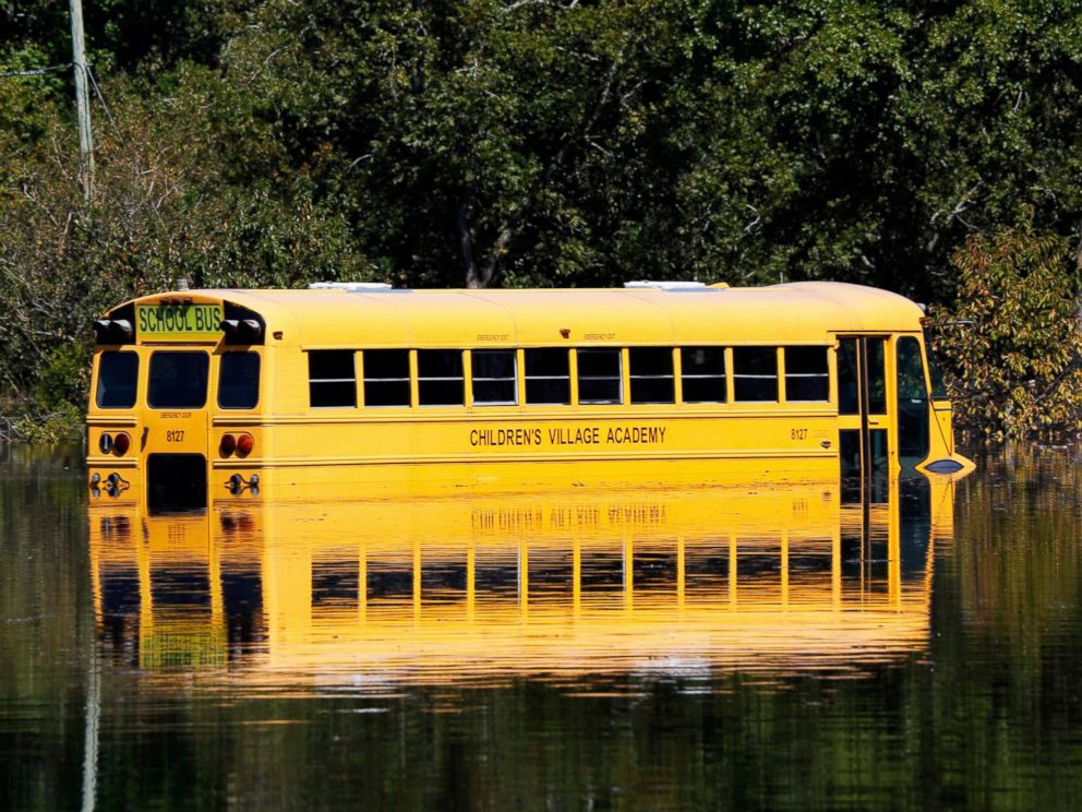 PHOTO: A school bus is pictured partially submerged as the Neuse River floods following Hurricane Matthew in Kinston, North Carolina, Oct. 12, 2016.