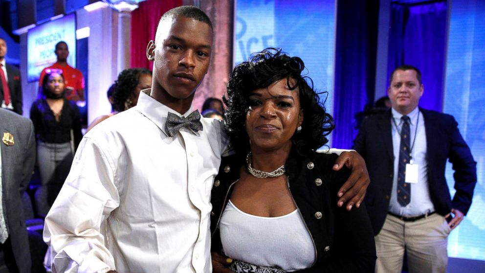 Baltimore mother Toya Graham who famously waded into a riot to retrieve her son Michael Singleton (L) stands with him after they joined U.S. President Barack Obama in a televised town hall about trust and safety in our communities in Washington, D.C., July 14, 2016.