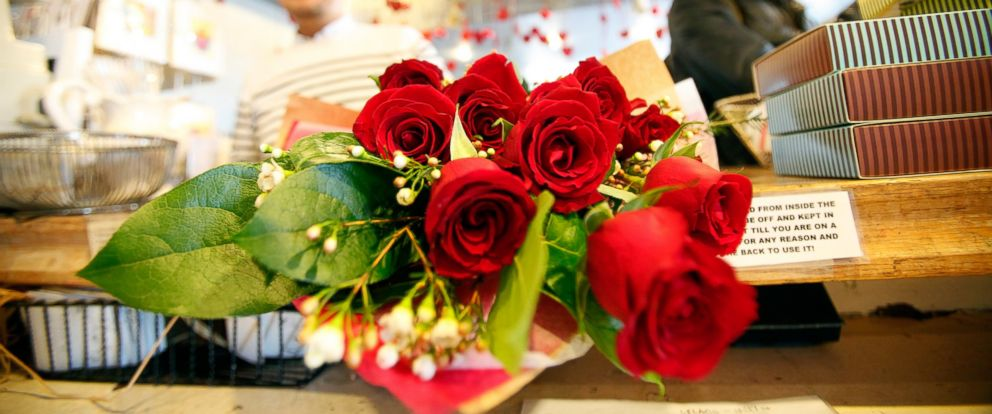 PHOTO: A person purchases roses at florist on Valentines Day in Los Angeles, Feb. 14, 2013.