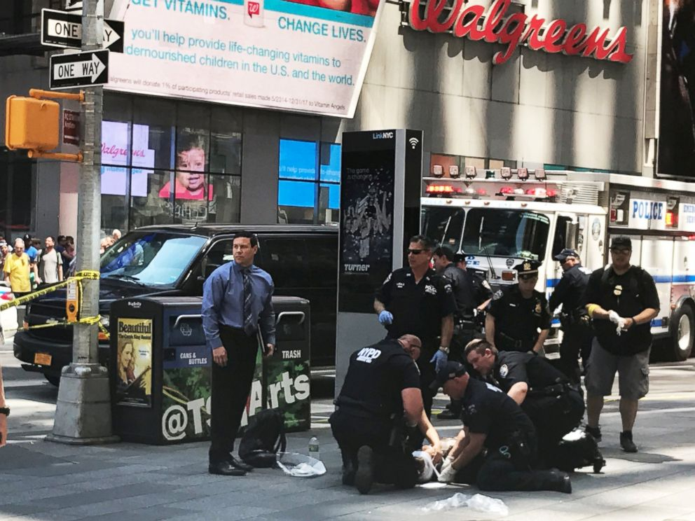 PHOTO: First responders are assisting injured pedestrians after a vehicle struck pedestrians on a sidewalk in Times Square in New York, May 18, 2017.