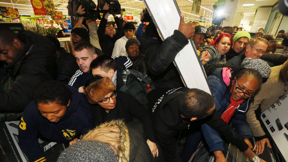 """Shoppers compete to purchase retail items on """"Black Friday"""" at an Asda superstore in Wembley, north London November 28, 2014."""