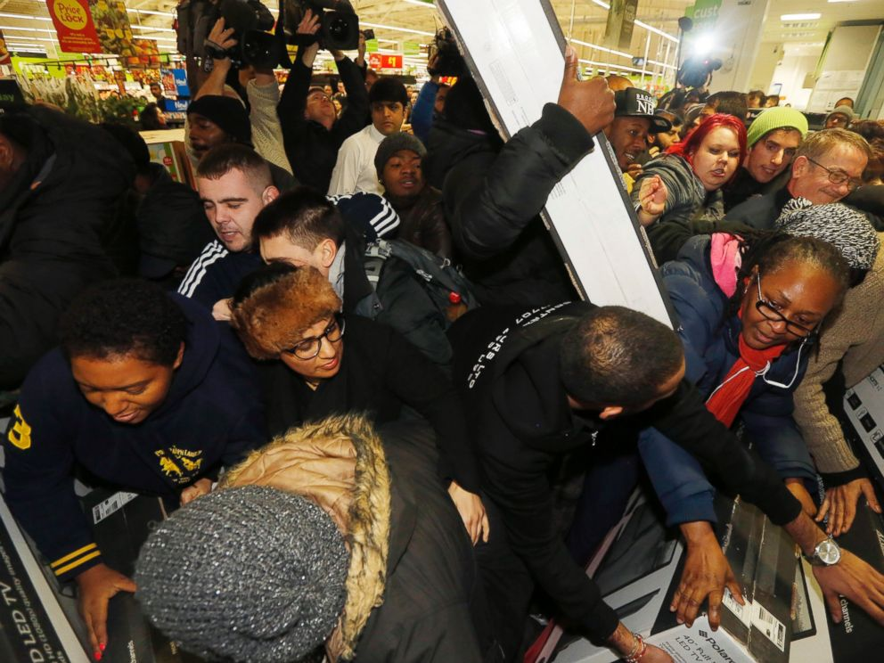 PHOTO: Shoppers compete to purchase retail items on Black Friday at an Asda superstore in Wembley, north London November 28, 2014.