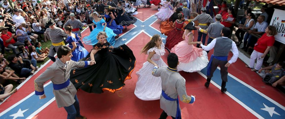 PHOTO: Descendants of American Southerners wearing Confederate-era dresses and uniforms dance during a party to celebrate the 150th anniversary of the end of the American Civil War in Santa Barbara DOeste, Brazil, April 26, 2015.
