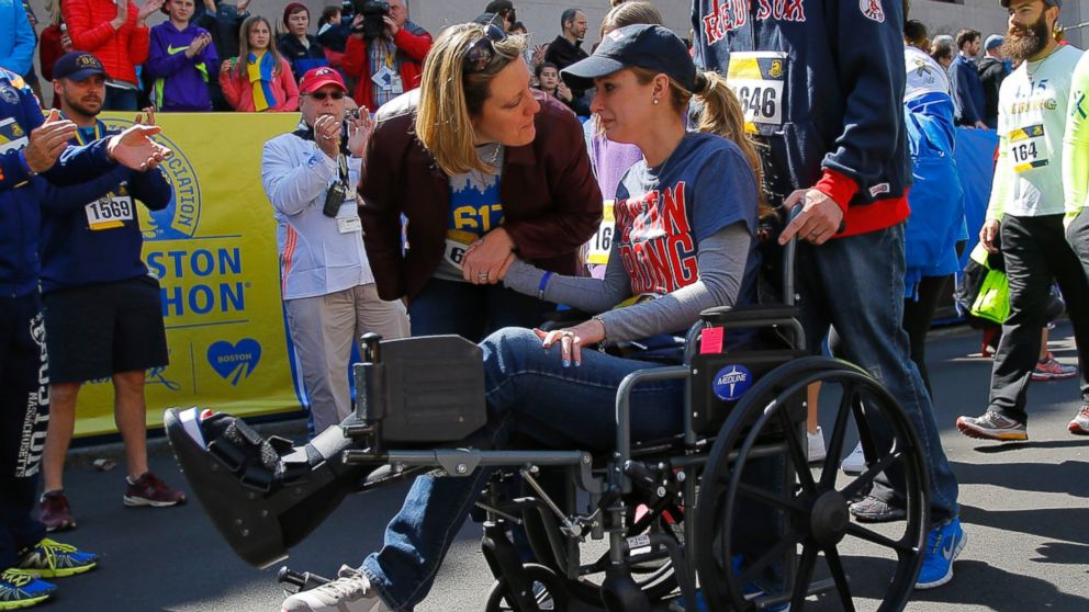 2013 Boston Marathon bombing survivor Rebekah Gregory DiMartino crosses the marathon finish line during a Tribute Run for survivors and first responders in Boston on April 19, 2014.