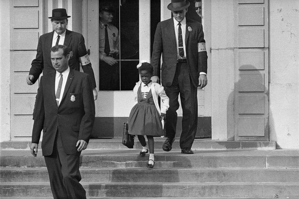 PHOTO: Deputy U.S. Marshals escort six-year-old Ruby Bridges from William Frantz Elementary School in New Orleans, La., in 1960.
