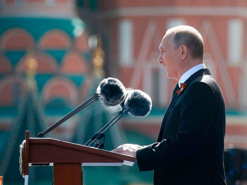 PHOTO: Russian President Vladimir Putin gives a speech during the Victory Day military parade at Red Square in Moscow, May 9, 2018.
