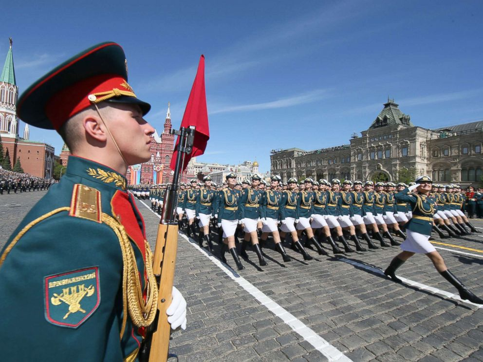PHOTO: Russian female soldiers (back) march during the Victory Day military parade in the Red Square in Moscow, May 9, 2018.